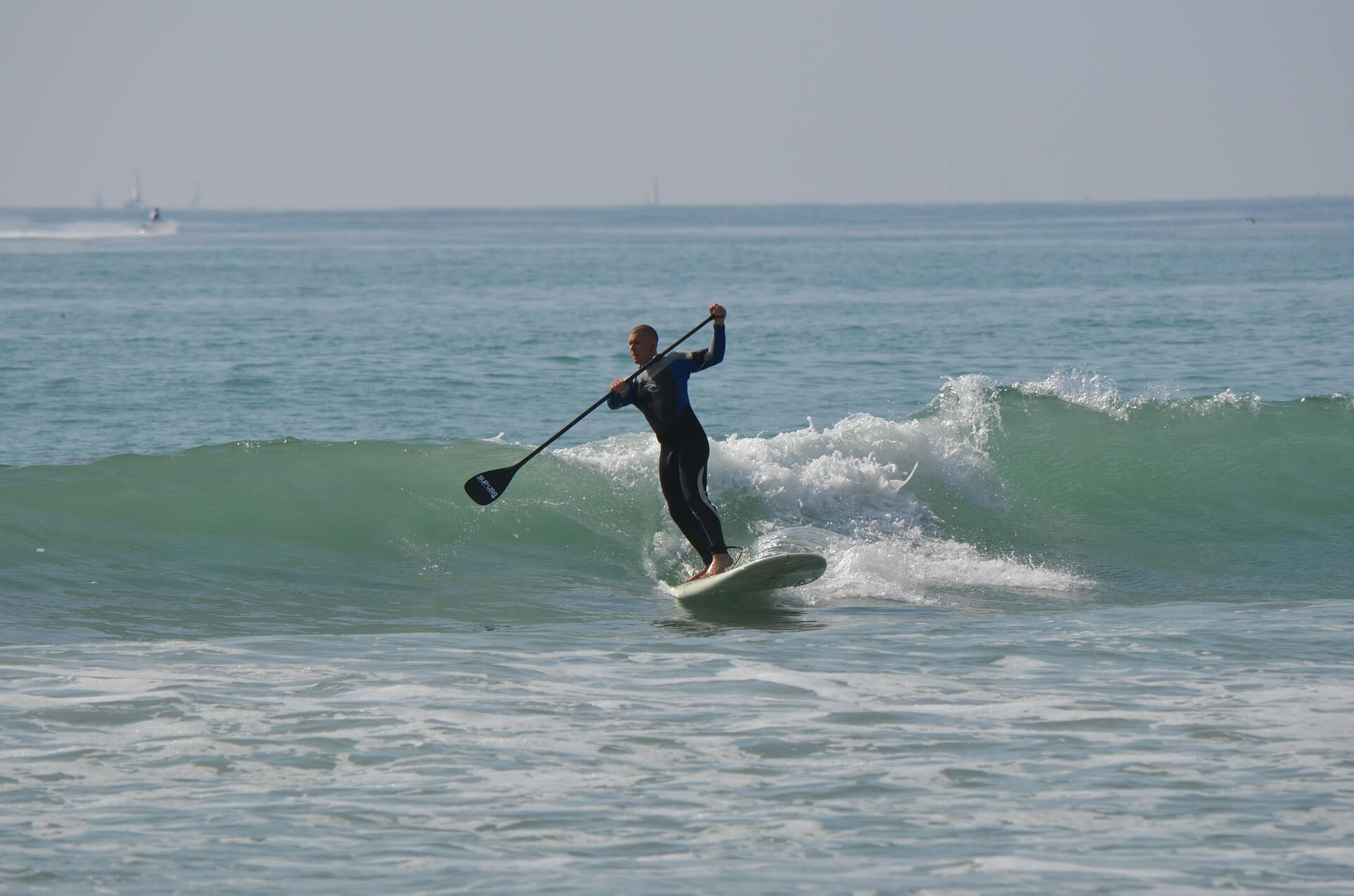 riding waves on a SUP board