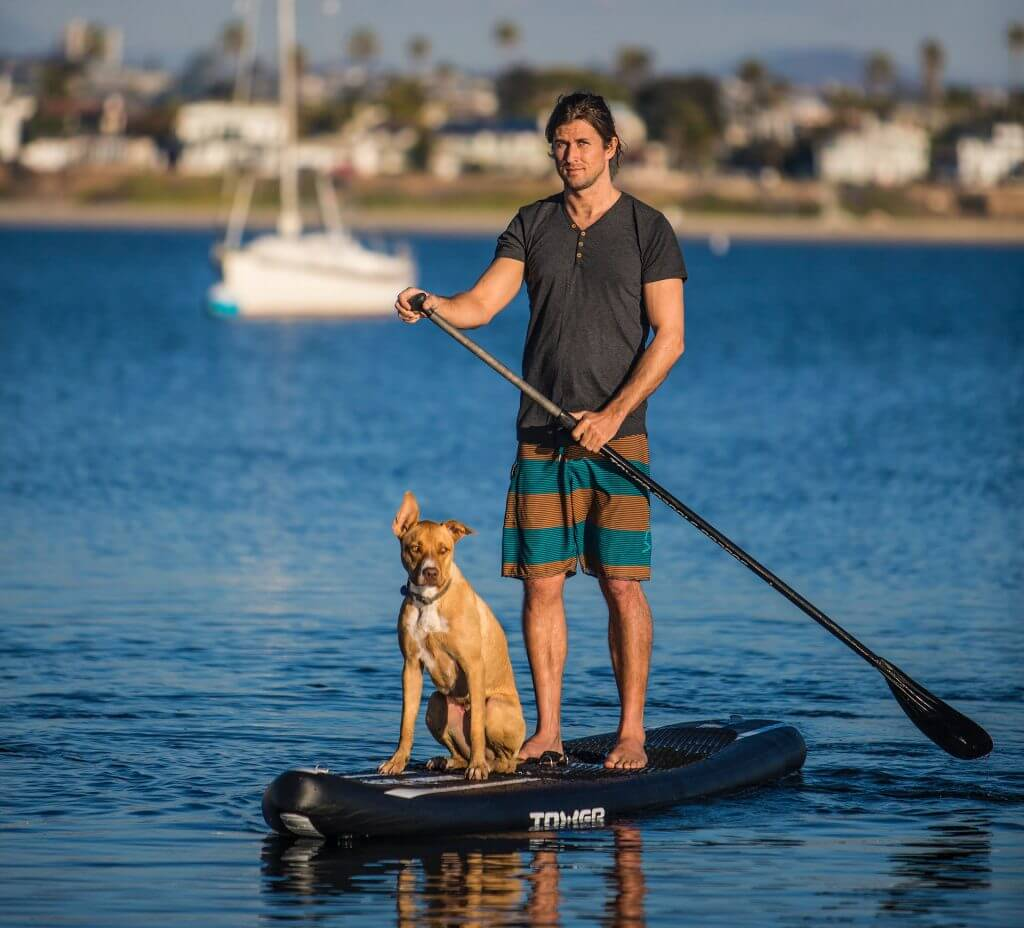 Man and dog on a SUP
