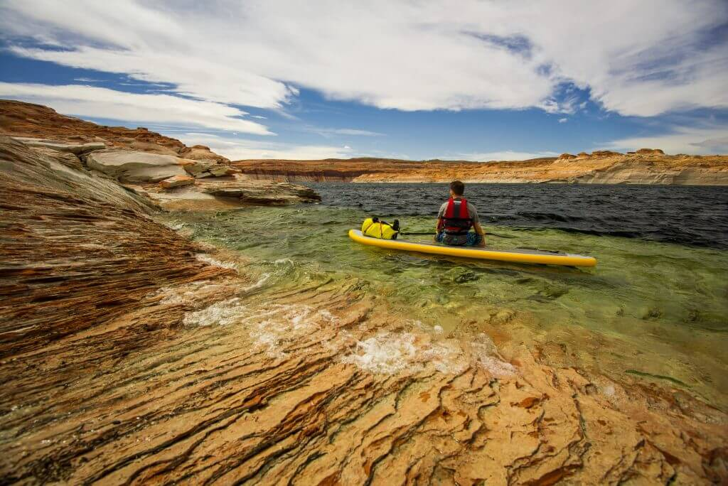 man wearing stand up paddle board life jacket