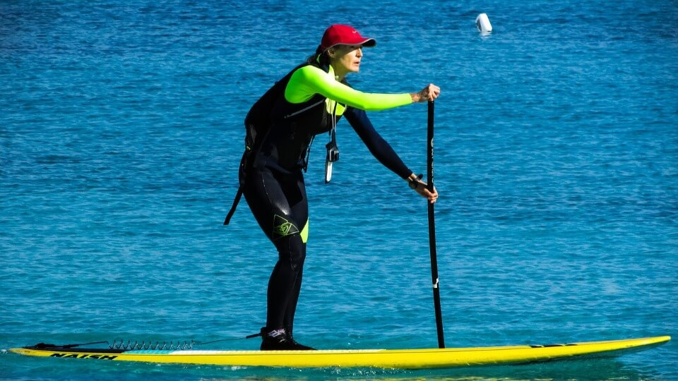 woman on a non inflatable sup looking forward