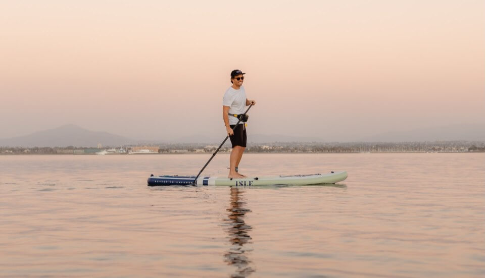 guy on a stand up sup on stable calm water